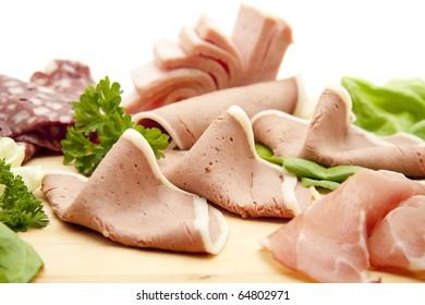 Sausage with salad onto plates
