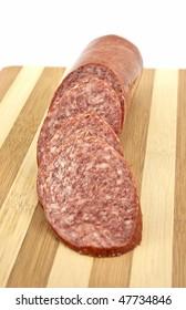 Sausage salami on the wooden desk background