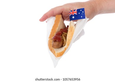 A sausage sizzle with Australian flag, isolated on white.