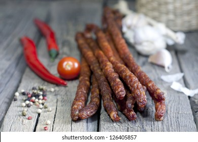 Sausage and spices on vintage wooden boards closeup