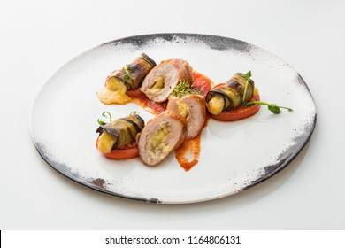 sausages with cheese in a plate isolated on white background.