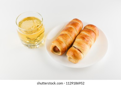 Sausages in a dough and a glass of beer for a quick lunch