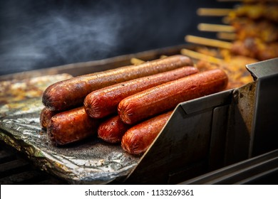 Sausages and kebabs on the grill at a food stand in New York City.