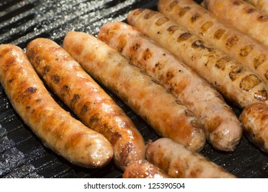 Sausages on a hot plate