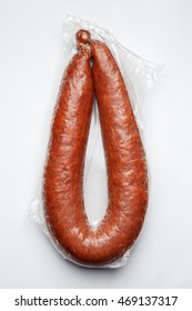 the sausages in vacuum pack isolated on gray background