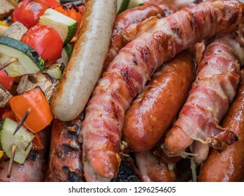 sausages and vegetables on a grill