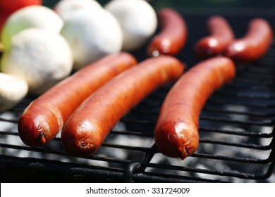 Sausages and vegetables on grill closeup
