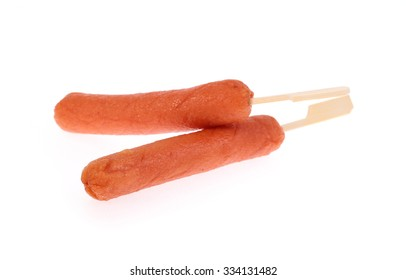 sausages with wooden stick isolated on white background