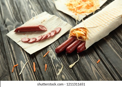 sausages wrapped in pita bread.preparation of Shawarma.photo wit