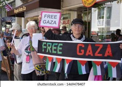 Sausalito, CA – August 3, 2019: Demonstrators in support of the, Flotilla for Gaza Solidarity protest to break the blockade of Gaza sponsored by Code Pink at the Sausalito Southern Marin ferry termina