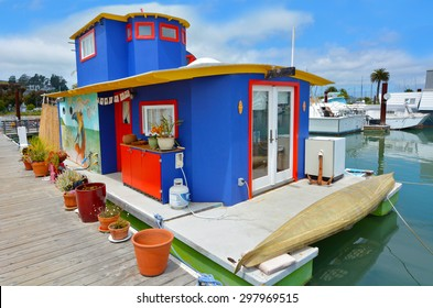 SAUSALITO, CA - MAY 21 2015:Colorful houseboat in Sausalito California.Sausalito known for it's unique houseboat community that consists of more than 400 houseboats of various shapes, colors and sizes