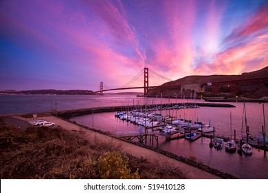 SAUSALITO, CA - SEPTEMBER 30, 2015: Boats moored at Horseshoe Bay, near Fort Baker, Sausalito in California at sunset. The Golden Gate Bridge is in the background.