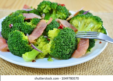 Sauteed broccoli salad with bacon and garlic, ketogenic low-carb diet food on plate