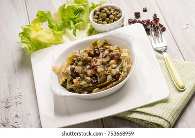 sauteed endive salad with caper dried grape and date fruit