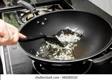 Sauteed garlic in a frying pan