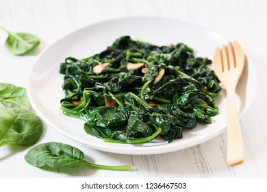 sauteed spinach with garlic on white plate