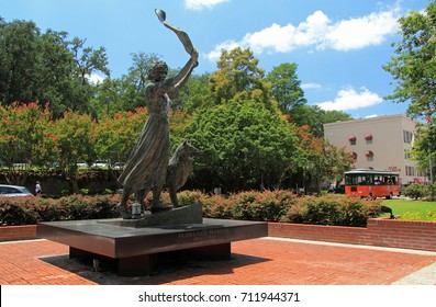 SAVANNAH, GA – JULY 22: A tribute to Florence Martus, the Waving Girl statue stands watch over the Savannah River July 22, 2017 in Savannah, GA