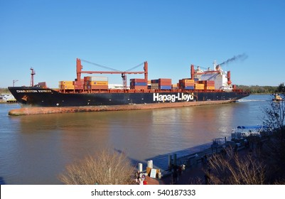 SAVANNAH, GA-10 DEC 2016- A container ship and stacked containers from cargo line Hapag-Lloyd on the Savannah River in Georgia. The Port of Savannah is a major seaport for the south of the US.
