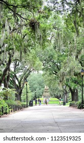 Savannah, GA/USA- 07/23/2017: Visitors to Forsyth Park walk past The Confederate monument.