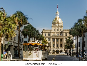 SAVANNAH, GEORGIA - December 19, 2018: Savannah is the oldest city in Georgia. From the historic architecture and parks to the local tour buses, Savannah attracts millions of visitors annually.