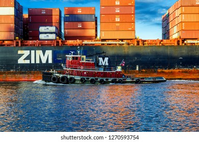 SAVANNAH, GEORGIA - December 4, 2015: Container ships now carry about 90 of the world's cargo and the largest container ships can carry over 21,000 units.
