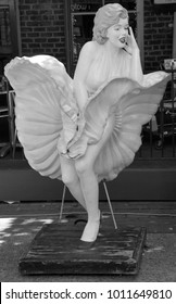 """SAVANNAH GEORGIA JUNE 29 2016:  Statue of the actress Marilyn Monroe iconic """"Seven Year Itch"""" subway grate moment in front of a restaurant in the City Market district"""