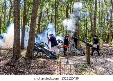 SAVANNAH GEORGIA, UNITED STATES - February 10, 2019: American Militia Firing Cannon in Savannah Georgia at a Colonial Faire