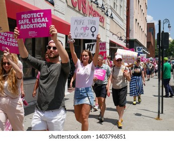 Savannah, Georgia / United States - May 21, 2019: Savannah Against the Bans! March against abortion bans in the state of Georgia. Women and men march from Johnson Square to Chippewa Square.