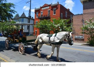 SAVANNAH GEORGIA USA 06 27 2016:  Horse and Carriage Tour of Historic Savannah nostalgic horse drawn carriage ride through the streets of Historic Savannah