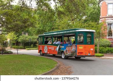 Savannah, Georgia, USA:  April 11th 2019; trolley tour bus carrying tourists in Savannah