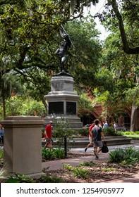 SAVANNAH, GEORGIA /U.S.A. - AUGUST 3, 2018: A photo of the bronze William Jasper Monument, 1888, in Madison Square.  Jasper was a revolutionary hero killed at the Siege of Savannah.