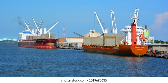 SAVANNAH GEORGIA USA JUNE 27 2016:  Port of Savannah is a major U. S. seaport. Its facilities for oceangoing vessels line both sides of the Savannah River 18 miles (29 km) from the Atlantic Ocean