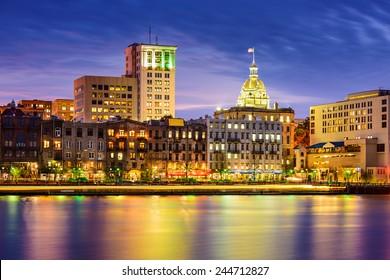 Savannah, Georgia, USA riverfront skyline at twilight.