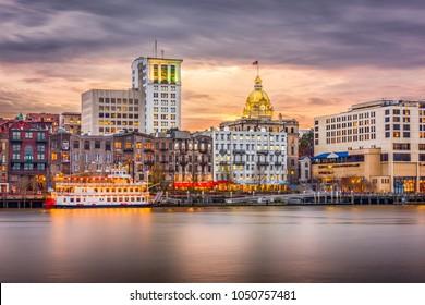 Savannah, Georgia, USA skyline on the river at dusk.