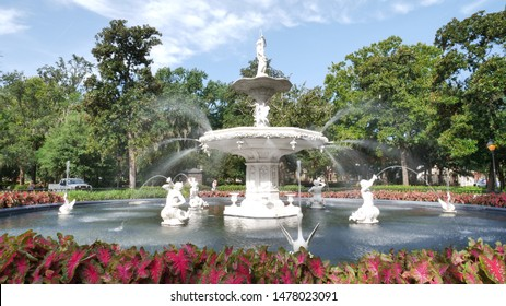 Savannah ,Georgia,July 12 2019,   Forsyth Savannah's Park Fountain with a beautiful garden around.