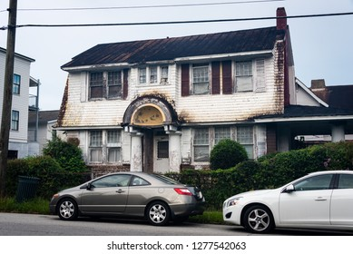 SAVANNAH, GEORGIA/U.S.A. - AUGUST 3, 2018: A photo of a blighted, historical two-story white house in the south Savannah area.
