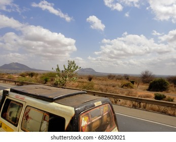 SAVANNAH, KENYA - SEPTEMBER 8 2013: View of the roadside on the road across Africa between Mombasa and Moshi towns