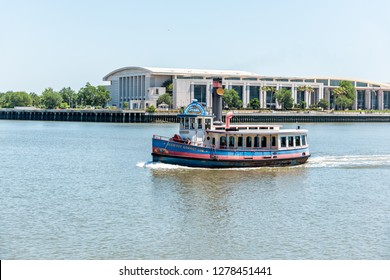 Savannah, USA - May 11, 2018: Old town River in Georgia famous southern town with Juliette Gordon Low ferry and view of Convention Center building