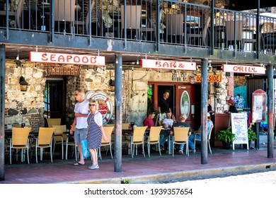 Savannah, USA - May 11, 2018: Old town River street in Georgia southern old town city with Dockside seafood bar grill restaurant by waterfront with people eating outdoors