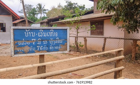 Savannakhet, Laos - March 22, 2014: The street sign in Laos show that here is Ban Vearn Nue village and population detail . This vlivage is at Xayboury district, Savannakhet Province in southern Laos.