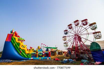 SAVANNAKHET,LAOS-OCTOBER 29,2017 : Giant slider and ferris wheel in Longtail boat racing festival in Savannakhet,Laos .This festival will be after end of Buddhist lent every year.