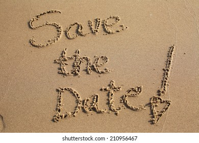 Save the date, a message written in the sand at the beach.