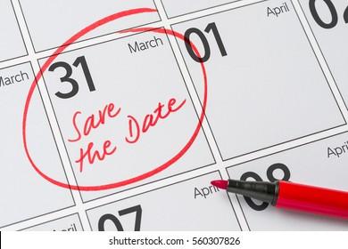 Save the Date written on a calendar - March 31