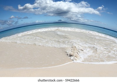 Save Earths Beaches global warming concept with stunning shore in the shape of our planet with island on the central Horizon