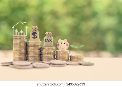 Save income tax and tax planning, child trust fund concept : Parents, wife and children in a home or house, US dollar bag, tax bag, piggy bank, small growing tree on rows of rising / increasing coins
