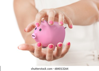 Save Investment Concept. Two Woman Hands Protecting Pink Piggy Bank on a white background.