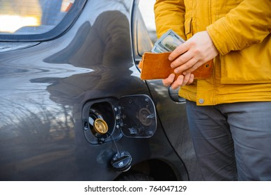 save money concept with LPG instead GAS man near car with money