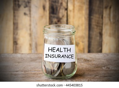Save money for HEALTH INSURANCE, concept money in the glass with filter effect retro vintage style