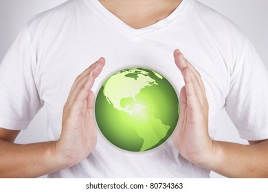 Save planet, male hands gesture to protect the green earth.