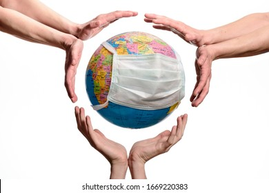 Save The World From The Coronavirus. Concept images of earth globe with a protective mask and hands, isolated on a white background. Human Epidemic Danger.